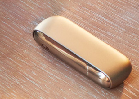 Brilliant gold IQOS 3 Duo holder and charger on a leather wallet