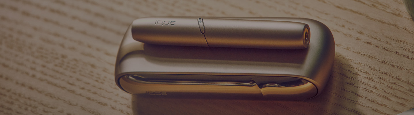 Young man opens his IQOS gift box